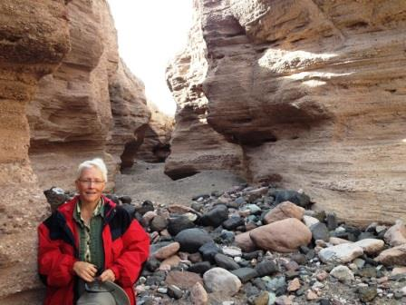 Carolyn poses for a photo while hiking in a slot canyon