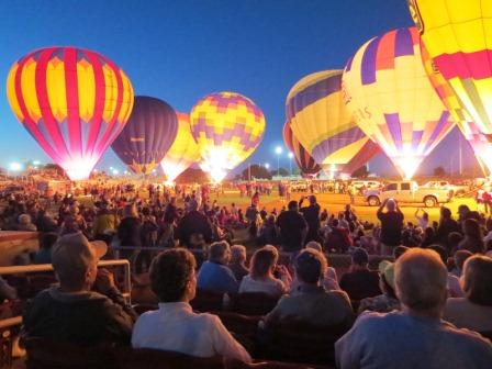 A stadium full of hot air balloons show off their colors